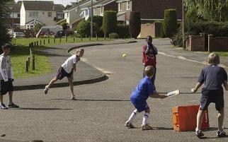 Children playing cricket in the park